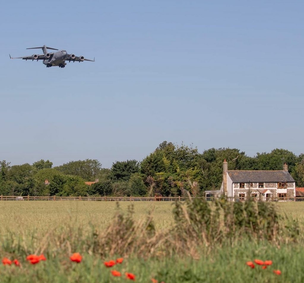 plane-flying-over-house