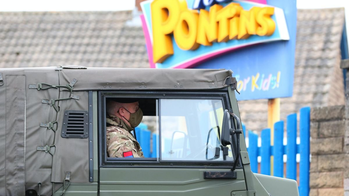 pontins-logo-behind-military-vehicle