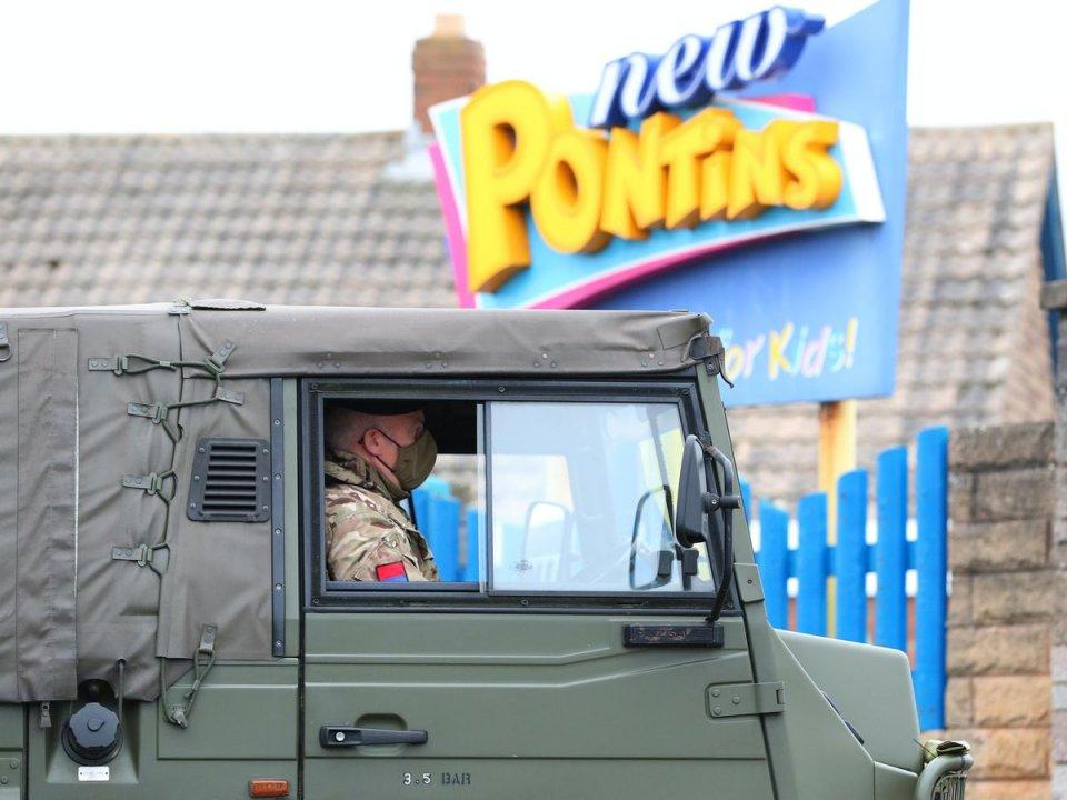 pontins-logo-behind-military-vehicle